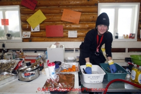 Friday March 9, 2012   Volunteer veterinarian Melissa Diederich helps with the cleaning chores inside the community center checkpoint at Ruby.  Iditarod 2012.
