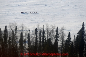 Deedee Jonrowe's team runs on the Yukon River between Eagle Island and Kaltag on Saturday March 9, 2013.Iditarod Sled Dog Race 2013Photo by Jeff Schultz copyright 2013 DO NOT REPRODUCE WITHOUT PERMISSION
