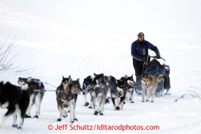 Sonny Lindner walks with his sled off the Yukon River and up the bank to the Kaltag checkpoint on Saturday March 9, 2013.Iditarod Sled Dog Race 2013Photo by Jeff Schultz copyright 2013 DO NOT REPRODUCE WITHOUT PERMISSION