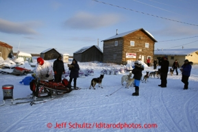 Aily Zirle checks in and out quickly at the Kaltag checkpoint on Saturday March 9, 2013.Iditarod Sled Dog Race 2013Photo by Jeff Schultz copyright 2013 DO NOT REPRODUCE WITHOUT PERMISSION
