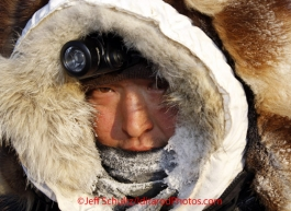 Tuesday March 13, 2012  Mike Williams, Jr. bundled up at the White Mountain checkpoint. Iditarod 2012.