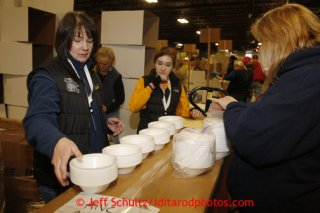 Friday, February 15, 2013.   Volunteer Teri Paton (L) and other volunteers count styrofoam bowls to be sent to out to the 22 checkpoints along the Iditarod trail during the
