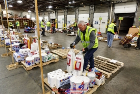 Iditarod volunteers sort and repackage human food and supplies for the trail volunteers to eat and use at each of the checkpoints on the 2018 Iditarod. The sorting is going on at the Airland Transport warehouse facilities in Anchorage Alaska on Friday  February 19, 2017.