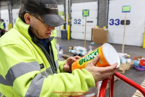 Iditarod volunteers examines a package of tang. The drink is an iconic part of the Iditarod sled dog race, at the Airland Transport warehouse facilities in Anchorage Alaska on Friday  February 19, 2017.