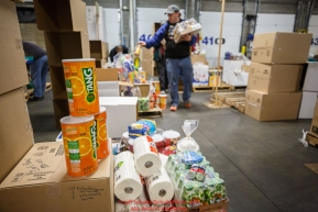 Iditarod drink ICON Tang and other supplies sit as Iditarod volunteers sort and repackage human food for the trail volunteers to eat at each of the checkpoints on the 2017 Iditarod. The sorting is going on at the Airland Transport warehouse facilities in Anchorage Alaska on Friday  February 17, 2017.Photo by Jeff Schultz/SchultzPhoto.com  (C) 2017  ALL RIGHTS RESVERVED
