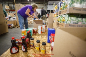 Iditarod volunteer Reb Hansen boxes up human food and supplies for the trail volunteers to eat at each of the checkpoints on the 2017 Iditarod. The sorting is going on at the Airland Transport warehouse facilities in Anchorage Alaska on Friday  February 17, 2017.Photo by Jeff Schultz/SchultzPhoto.com  (C) 2017  ALL RIGHTS RESVERVED