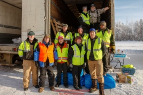 Logistics volunteers pose for a group photo on the day the Iditarod Air Force flies out food and supplies to checkpoints before the 2018 race from the Willow airport in Willow, Alaska Photo by Judy Patrick/SchultzPhoto.com  (C) 2018  ALL RIGHTS RESERVED