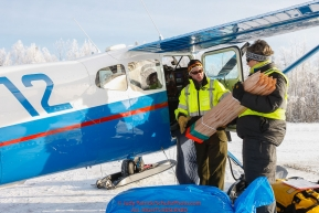 Volunteer load coordinator Leslie Washburn helps pilot Scott Ivany load his plane with trail markers as the Iditarod Air Force flies out food and supplies to checkpoints on Saturday February 17th  before the 2018 race from the Willow airport in Willow, Alaska Photo by Judy Patrick/SchultzPhoto.com  (C) 2018  ALL RIGHTS RESERVED