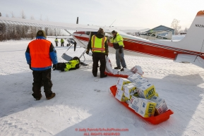 Volunteers help load a plane as the Iditarod Air Force flies out food and supplies to checkpoints before the 2018 race from the Willow airport in Willow, Alaska Photo by Judy Patrick/SchultzPhoto.com  (C) 2018  ALL RIGHTS RESERVED