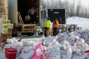 Race Marshal and Manager Mark Nordman unloads a bale of straw from van full of supplies as the Iditarod Air Force flies out food and supplies to checkpoints on Saturday February 17th before the 2018 race from the Willow airport in Willow, Alaska Photo by Judy Patrick/SchultzPhoto.com  (C) 2018  ALL RIGHTS RESERVED