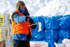 Logistics volunteer Chris Blankenship keeps track of supplies as the Iditarod Air Force flies out food and supplies to checkpoints on Saturday February 17th before the 2018 race from the Willow airport in Willow, Alaska Photo by Judy Patrick/SchultzPhoto.com  (C) 2018  ALL RIGHTS RESERVED