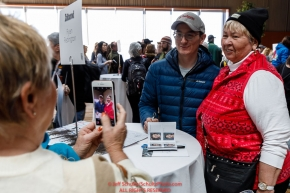 Ryan Redington has his photo taken with a race fan at the musher pre-race banquet at the Denaina Convention center for Iditarod 2019Photo by Jeff Schultz/  (C) 2019  ALL RIGHTS RESERVED
