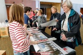 Face fans get their free ExxonMobil poster at the musher pre-race banquet at the Denaina Convention center for Iditarod 2019Photo by Jeff Schultz/  (C) 2019  ALL RIGHTS RESERVED