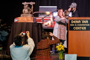 Matthew Failor picks his drawing position from a mukluk at the pre-race musher drawing banquet at the Dena'ina convention center in Anchorage, Alaska prior to the 2019 Iditarod Trail Sled Dog RacePhoto by Jeff Schultz/  (C) 2019  ALL RIGHTS RESERVED