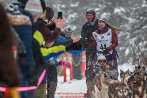 Tara Cicatello gives high-fives to spectators on the bike/ski trail during the ceremonial start day of the 2018 Iditarod in Anchorage, Alaska on Saturday, March 3 2018.Photo by Jeff Schultz/SchultzPhoto.com  (C) 2018  ALL RIGHTS RESERVED