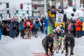 Andy Pohl waves to the crowd as he leaves the start line during the ceremonial start of the 2018 Iditarod in Anchorage, Alaska on Saturday, March 3, 2018.Photo by Jeff Schultz/SchultzPhoto.com  (C) 2018  ALL RIGHTS RESERVED