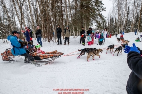 Jessie Holmes rounds a corner on the bike/ski trail as fans look on during the ceremonial start day of the 2018 Iditarod in Anchorage, Alaska on Saturday, March 3 2018.Photo by Jeff Schultz/SchultzPhoto.com  (C) 2018  ALL RIGHTS RESERVED