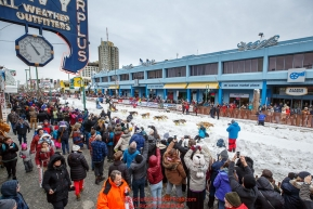 Matt Hall runs down 4th avenue after leaving the start line during the ceremonial start of the 2018 Iditarod in Anchorage, Alaska on Saturday, March 3,  2018.Photo by Jeff Schultz/SchultzPhoto.com  (C) 2018  ALL RIGHTS RESERVED