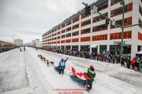 Michelle Phillips waves to the crowd as she runs down 4th avenue during the ceremonial start of the 2018 Iditarod in Anchorage, Alaska on Saturday, March 3, 2018.Photo by Jeff Schultz/SchultzPhoto.com  (C) 2018  ALL RIGHTS RESERVED