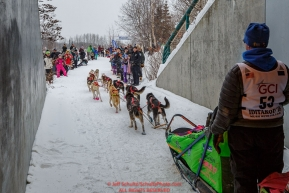 Alan Eischens exits an overpass tunnel on the bike/ski trail  as spectators line the trail during the ceremonial start day of the 2018 Iditarod in Anchorage, Alaska on Saturday, March 3 2018.Photo by Jeff Schultz/SchultzPhoto.com  (C) 2018  ALL RIGHTS RESERVED