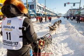 Ketil Reitan runs down the start chute during the Ceremonial Start of the 2017 Iditarod in Anchorage on Saturday March 4, 2017 Photo by Jeff Schultz/SchultzPhoto.com  (C) 2017  ALL RIGHTS RESVERVED