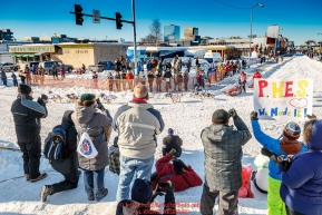 Aliy Zirkle rounds the turn at 4th Avenue and Cordova Street as spectators watch during the Ceremonial Start of the 2017 Iditarod in Anchorage on Saturday March 4, 2017 Photo by Jeff Schultz/SchultzPhoto.com  (C) 2017  ALL RIGHTS RESVERVED