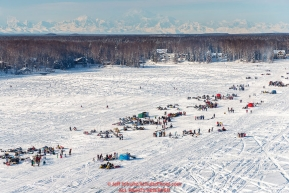 A teams runs on Long Lake amongst the crowds during the Official Re-Start of the 2018 Iditarod Sled Dog Race in Willow, Alaska on March 04, 2018.  The Alaska Range in the backgroundPhoto by Jeff Schultz/SchultzPhoto.com  (C) 2018  ALL RIGHTS RESERVED