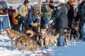Handlers trying to hold back excited dogs on Willow Lake at the Official Start of the 2018 Iditarod Sled Dog Race in Willow, Alaska on March 04, 2018. Photo by Jeff Schultz/SchultzPhoto.com  (C) 2018  ALL RIGHTS RESERVED