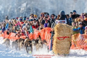 Michelle Phillips carrying the essential bail of straw on Willow Lake at the Official Start of the 2018 Iditarod Sled Dog Race in Willow, Alaska on March 04, 2018. Photo by Jeff Schultz/SchultzPhoto.com  (C) 2018  ALL RIGHTS RESERVED