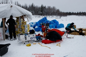A team arrives at Nikolai on the river as volunteers work in the checkpoint at the Nikolai checkpoint during the 2018 Iditarod race on Tuesday afternoon March 06, 2018. Photo by Jeff Schultz/SchultzPhoto.com  (C) 2018  ALL RIGHTS RESERVED