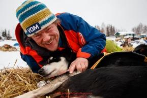 Lars Monsen massages the wrist of his dog