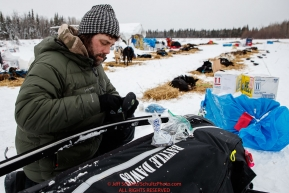 Rick Casillo changes sled runners at the Nikolai checkpoint during the 2018 Iditarod race on Tuesday afternoon March 06, 2018. Photo by Jeff Schultz/SchultzPhoto.com  (C) 2018  ALL RIGHTS RESERVED