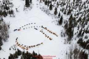 One team passes another as three teams rest at the buffalo camp  area between Rohn and Nikolai during the 2018 Iditarod race on Tuesday afternoon March 06, 2018.  Photo by Jeff Schultz/SchultzPhoto.com  (C) 2018  ALL RIGHTS RESERVED
