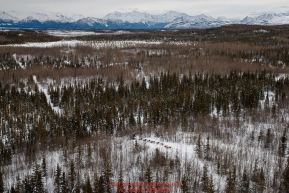 A team runs through the hills in the Farewell Burn area between Rohn and Nikolai during the 2018 Iditarod race on Tuesday afternoon March 06, 2018. Photo by Jeff Schultz/SchultzPhoto.com  (C) 2018  ALL RIGHTS RESERVED