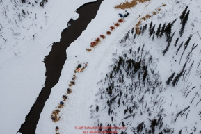 Two teams near a creek with open water 22 miles from the Rohn checkpoint on the way to Nikolai during the 2018 Iditarod race on Tuesday afternoon March 06, 2018. Photo by Jeff Schultz/SchultzPhoto.com  (C) 2018  ALL RIGHTS RESERVED