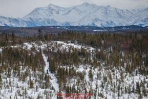 A team runs downhill in the Farewell Burn area between Rohn and Nikolai with the Alaska Range in the background during the 2018 Iditarod race on Tuesday afternoon March 06, 2018. Photo by Jeff Schultz/SchultzPhoto.com  (C) 2018  ALL RIGHTS RESERVED
