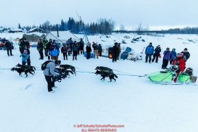 Ryan Redington arrives in first place at the Nikolai checkpoint to a warm welcome of residents during the 2018 Iditarod race on Tuesday morning March 06, 2018. Photo by Jeff Schultz/SchultzPhoto.com  (C) 2018  ALL RIGHTS RESERVED