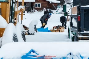 Joar Leifseth Ulsom gives his dogs straw while he rests at the Nikolai checkpoint during the 2018 Iditarod race on Tuesday March 06, 2018. Photo by Jeff Schultz/SchultzPhoto.com  (C) 2018  ALL RIGHTS RESERVED