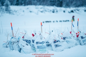 Musher food drop bags await their arrival at the Nikolai checkpoint as Ryan Redington approaches on the river during the 2018 Iditarod race on Tuesday March 06, 2018. Photo by Jeff Schultz/SchultzPhoto.com  (C) 2018  ALL RIGHTS RESERVED