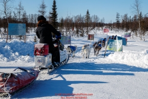 Katherine Keith runs past welcoming signs as she heads into the checkpoint at Manley Hot Springs during the 2017 Iditarod on Tuesday March 7, 2017.Photo by Jeff Schultz/SchultzPhoto.com  (C) 2017  ALL RIGHTS RESVERVED
