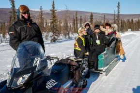 Volunteers get a ride from the community hall to the at the checkpoint in Manley Hot Springs during the 2017 Iditarod on Tuesday March 7, 2017.Photo by Jeff Schultz/SchultzPhoto.com  (C) 2017  ALL RIGHTS RESVERVED