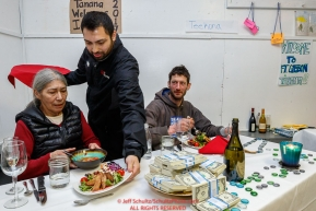 Nicolas Petit and Tanana Elder Blanche Edwin is served by The Lakefront Hotel's Andrew Adlesperger during his