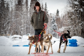 Nick Petit takes his dogs for a walk during his 24-hour layover in the afternoon at the McGrath checkpoint during the 2018 Iditarod race on Wednesday March 07, 2018. Photo by Jeff Schultz/SchultzPhoto.com  (C) 2018  ALL RIGHTS RESERVED
