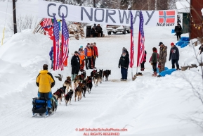 Andy Pohl is greeted by volunteers in the afternoon at the Takotna checkpoint during the 2018 Iditarod race on Wednesday March 07, 2018. Photo by Jeff Schultz/SchultzPhoto.com  (C) 2018  ALL RIGHTS RESERVED