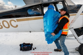 Volunteer Daniel Hayden upacks his plane in McGrath after helping clean out the Rohn checkpoint during the 2018 Iditarod race on Wednesday March 07, 2018. Photo by Jeff Schultz/SchultzPhoto.com  (C) 2018  ALL RIGHTS RESERVED