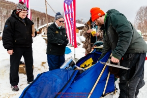 Volunteers Nell Huffman and Susan Smith check in Andy Farquar in the afternoon at the Takotna checkpoint during the 2018 Iditarod race on Wednesday March 07, 2018. Photo by Jeff Schultz/SchultzPhoto.com  (C) 2018  ALL RIGHTS RESERVED