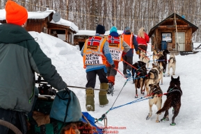 Volunteers from Norway park Bradley Farquar's dogs for a 24-hour layover in the afternoon at the Takotna checkpoint during the 2018 Iditarod race on Wednesday March 07, 2018. Photo by Jeff Schultz/SchultzPhoto.com  (C) 2018  ALL RIGHTS RESERVED