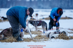 Lev Shvarts (r) and Andrew Nolan boot their dog teams in the morning at the Nikolai checkpoint during the 2018 Iditarod race on Wednesday March 07, 2018. Photo by Jeff Schultz/SchultzPhoto.com  (C) 2018  ALL RIGHTS RESERVED