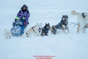 Marcelle Fressineau runs up the river bank in the morning at the Nikolai checkpoint during the 2018 Iditarod race on Wednesday March 07, 2018. Photo by Jeff Schultz/SchultzPhoto.com  (C) 2018  ALL RIGHTS RESERVED