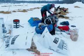 Shaynee Traska packs her sled in the morning at the Nikolai checkpoint during the 2018 Iditarod race on Wednesday March 07, 2018. Photo by Jeff Schultz/SchultzPhoto.com  (C) 2018  ALL RIGHTS RESERVED